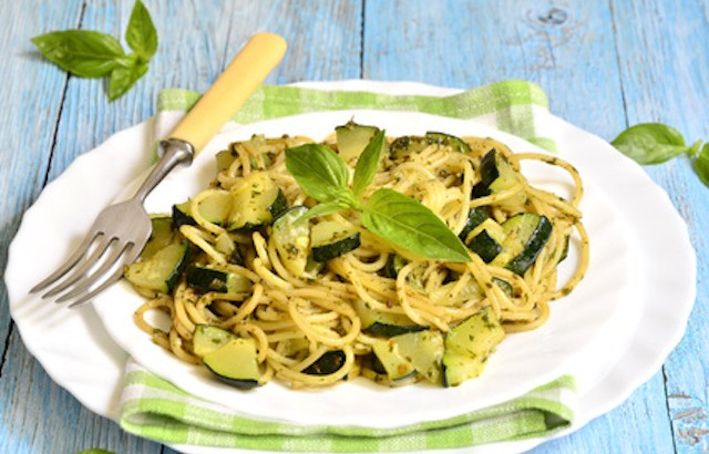 Spaghetti with zucchini and basil pesto.
