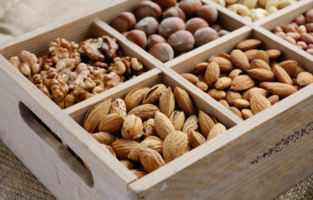 Nut mix in wooden box - walnut, almond, hazelnut, cashew and peanuts